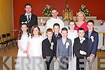 HOLY COMMUNION: The students of Adam Breen class at Clogher NS who made their First Holy Communion at the St Brendan's Church, Clogher on Saturday front l-r: Caoimhe McCarthy, Ellie Lenihan, Gene Brosnan, Denis Brosnan, Maurice O'Connell, Rachel O'Connor, Darren Breen and Adam Kelly. Back l-r: Adam Breen (class teacher), Fr Pat Crean-Lynch and Sinead Murphy (principal).