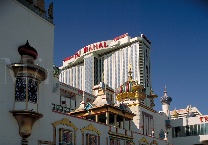 Looking up from the boardwalk to the ornate Trump Taj Mahal Hotel & Casino, in Atlantic City, New Jersey. gambling, architecture. Atlantic City New Jersey.