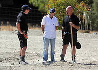 Pictured: Eddie Needham (C), the grandfather of missing Ben Needham, is shown around the soil examination process by an officer in Kos, Greece. Wednesday 05 October 2016<br />