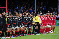 The Saracens and Scarlets teams line up for a minutes silence in honour of the late Anthony Foley. European Rugby Champions Cup match, between Saracens and the Scarlets on October 22, 2016 at Allianz Park in London, England. Photo by: Patrick Khachfe / JMP