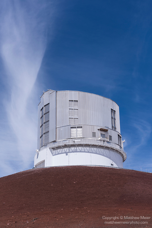 Mauna Kea, Big Island of Hawaii, Hawaii; a view of the Subaru Telescope at the summit of the Mauna Kea Observatories (MKO), currently there are 13 independent multi-national astronomical research facilities located on the summit. Mauna Kea's altitude and isolation in the middle of the Pacific ocean make it an ideal location for astronomical observation.