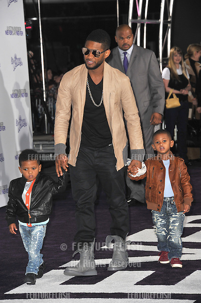 "Usher & children at the Los Angeles premiere of ""Justin Bieber: Never Say Never"" at the Nokia Theatre LA Live..February 8, 2011  Los Angeles, CA.Picture: Paul Smith / Featureflash"