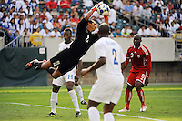 Honduras (HON) goalkeeper Donis Escober (22) comes off his line to grab a ball during a quarterfinal match of the CONCACAF Gold Cup against Canada (CAN) at Lincoln Financial Field in Philadelphia, PA, on July 18, 2009.