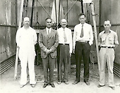 Standing in front of the rocket in the launch tower on September 23, 1935, are (left to right): Albert Kisk, Goddard's brother-in-law and machinist; Harry F. Guggenheim; Doctor Robert H. Goddard; Colonel Charles A. Lindbergh and N.T. Ljungquist, machinist. Charles Lindbergh, an advocate for Goddard and his research, helped secure a grant from the Daniel and Florence Guggenheim Foundation in 1930. With that money Goddard and his wife moved to Roswell, New Mexico, where he could conduct research and launch rockets while avoiding the scrutiny and criticism of his colleagues and the press. .Credit: NASA via CNP