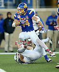 BROOKINGS, SD - NOVEMBER 12:  Brady Mengerelli #44 from South Dakota State University bowls over a defender from the University of South Dakota in the first second at the Dana J. Dykhouse Stadium November 12, 2016 in Brookings, South Dakota. (Photo by Dave Eggen/Inertia)
