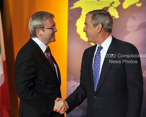 Washington, D.C. - November 15, 2008 -- United States President George W. Bush welcomes Prime Minister Kevin Rudd of Australia to the Summit on Financial Markets and the World Economy leaders to the National Building Museum in Washington, D.C. on Saturday, November 15, 2008..Credit: Ron Sachs / Pool via CNP