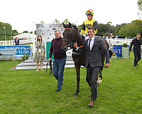 Winner of The Irish Thoroughbred Marketing Novice Stakes  Kenzai Warrior ridden by Jason Watson and trained by Roger Teal is led into the Winner's enclosure during Racing at Salisbury Racecourse on 5th September 2019