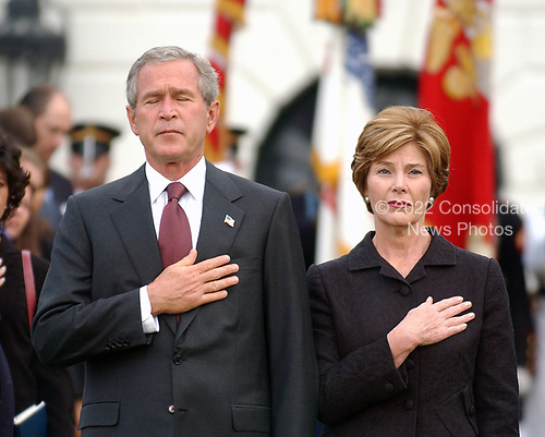 Washington, D.C. - September 11, 2004 --  United States President George W. Bush and first lady Laura Bush observe a moment of silence marking 3 years from the moment of the first terrorist attack on the World Trade Center in New York on September 11, 2001.<br /> Credit: Ron Sachs / CNP