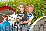 First cousins Jack Connolly and Ella Foly, from Glin, get the feel of one of the tractors on display at the Vintage Day in Knockanure on Sunday...   Copyright Kerry's Eye 2008