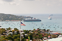 American flag overlooking cruise ships entering the harbor at Charlotte Amalie, U.S. Virgin Islands.