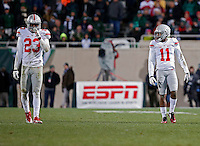 Ohio State Buckeyes safety Tyvis Powell (23) Ohio State Buckeyes defensive back Vonn Bell (11) against Michigan State Spartans at Spartan Stadium in East Lansing, Michigan on November 8, 2014.  (Dispatch photo by Kyle Robertson)