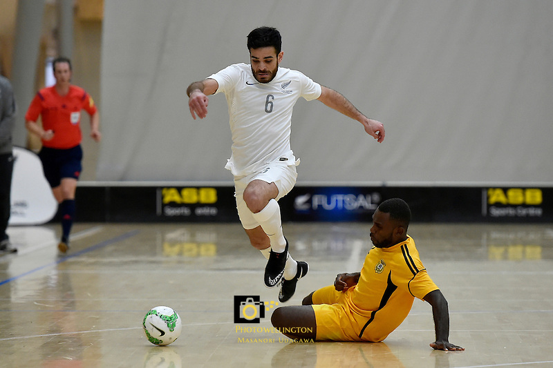 from left Futsal Whites' Kareem Osman and Vanuatu Gideons&rsquo; Luis Fifas in action during the Commonwealth Futsal Cup - New Zealand v Vanuatu at ASB Sports Centre, Wellington, New Zealand on Sunday 12 July 2015.<br /> Photo by Masanori Udagawa. <br /> www.photowellington.photoshelter.com.