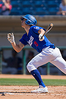 Rancho Cucamonga Quakes Donovan Casey (19) follows through on his swing against the Lake Elsinore Storm at LoanMart Field on April 22, 2018 in Rancho Cucamonga, California. The Storm defeated the Quakes 8-6.  (Donn Parris/Four Seam Images)