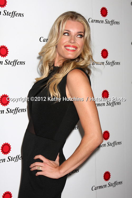 LOS ANGELES - AUG 2:  Rebecca Romijn arrives at the Carmen Steffens West Coast Flagship Store Opening at Hollywood & Highland on August 2, 2012 in Los Angeles, CA