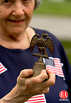 WARREN, CT --JULY 04, 2008-070408JS03-Dorothy Maier of Warren, holds a bell cast in the 1980's for the annual Warren Independence Day bell ringing ceremony Friday. The event was sponsored by the Warren Historical Society. <br /> Jim Shannon/Republican-American