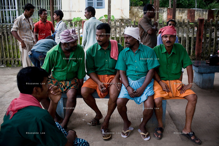 Porters rest and chat at Kottayam Stn., Kerala on 9th July 2009.. .6318 / Himsagar Express, India's longest single train journey, spanning 3720 kms, going from the mountains (Hima) to the seas (Sagar), from Jammu and Kashmir state of the Indian Himalayas to Kanyakumari, which is the southern most tip of India...Photo by Suzanne Lee / for The National