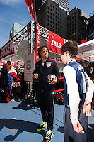 former men's national team player Cobi Jones talks with a fan during the centennial celebration of U. S. Soccer at Times Square in New York, NY, on April 04, 2013.