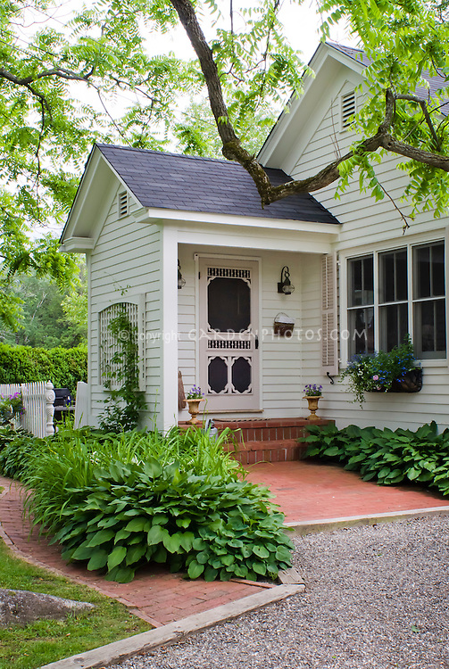Curb Appeal Shaded Front Entrance Porch Of House With