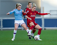 1st December 2019; Academy Stadium, Manchester, Lancashire, England; The FA's Women's Super League, Manchester City Women versus Liverpool Women; Rhiannon Roberts of Liverpool FC Women is tackled by Lauren Hemp of Manchester City Women - Editorial Use