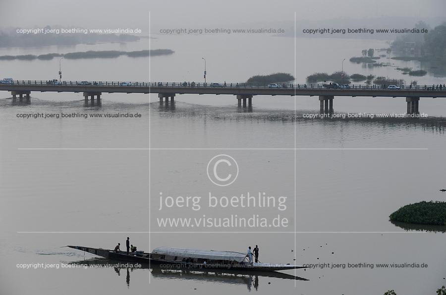 NIGER Niamey, river Niger, Kennedy bridge and pirogue wooden boat