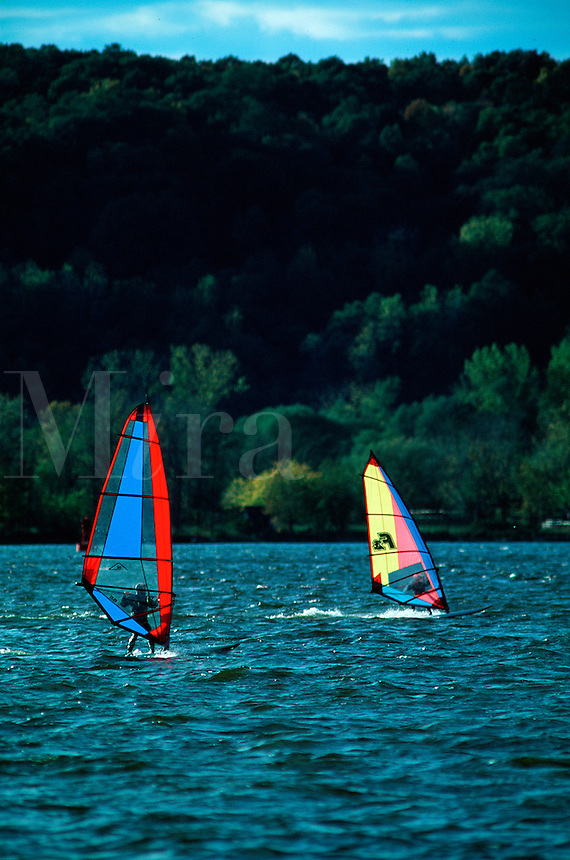 Wind surfers on the Hudson River. Kingston, New York.
