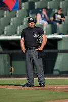 Home plate umpire Alex Trujillo between innings of the South Atlantic League game between the Hagerstown Suns and the Kannapolis Intimidators at Intimidators Stadium on July 18, 2015 in Kannapolis, North Carolina.  The Intimidators defeated the Suns 1-0.  (Brian Westerholt/Four Seam Images)