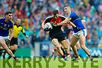 James O'Donoghue Kerry in action against Chris Barrett Mayo in the All Ireland Semi Final in Croke Park on Sunday.