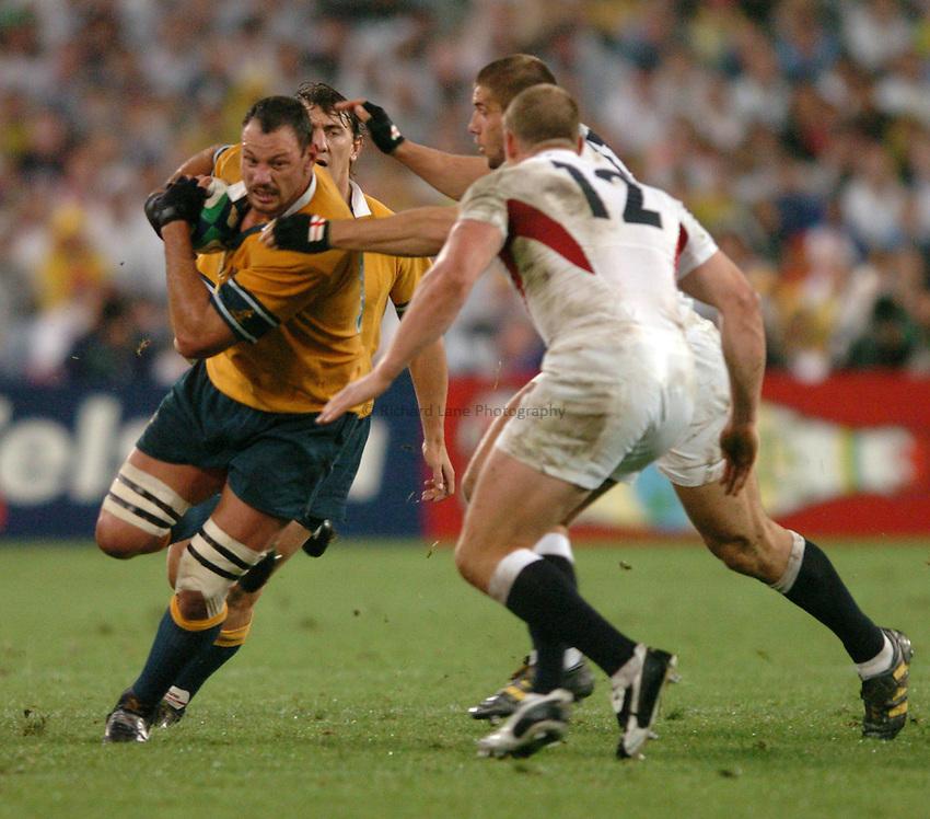 Photo: Richard Lane..Australia v England. Rugby World Cup Final, at the Telstra Stadium, Sydney. RWC 2003. 22/11/2003. .Matt Cockbain attacks.