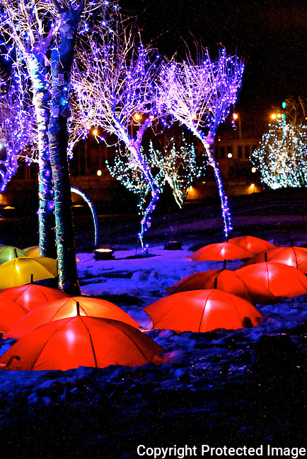 Colorful umbrellas and lights along river bank winter photo