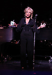 Kristin Chenoweth with a Starbucks Coffee Mug.performing in Kristin Chenoweth World Tour directed by Richard Jay Alexander at City Center in New York City on 6/02/2012