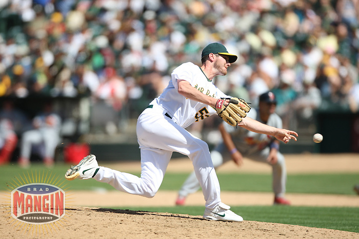 OAKLAND, CA - June 17:  Jay Marshall of the Oakland Athletics pitches during the game against the St. Louis Cardinals at the McAfee Coliseum in Oakland, California on June 17, 2007.  The Cardinals defeated the Athletics 10-6.  Photo by Brad Mangin