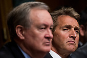 UNITED STATES - SEPTEMBER 27: Sen. Mike Crapo, R-Idaho, left, and Sen. Jeff Flake, R-Ariz., listen as  Dr. Christine Blasey Ford testifies during the Senate Judiciary Committee hearing on the nomination of Brett M. Kavanaugh to be an associate justice of the Supreme Court of the United States, focusing on allegations of sexual assault by Kavanaugh against Christine Blasey Ford in the early 1980s. (Photo By Tom Williams/CQ Roll Call/POOL)