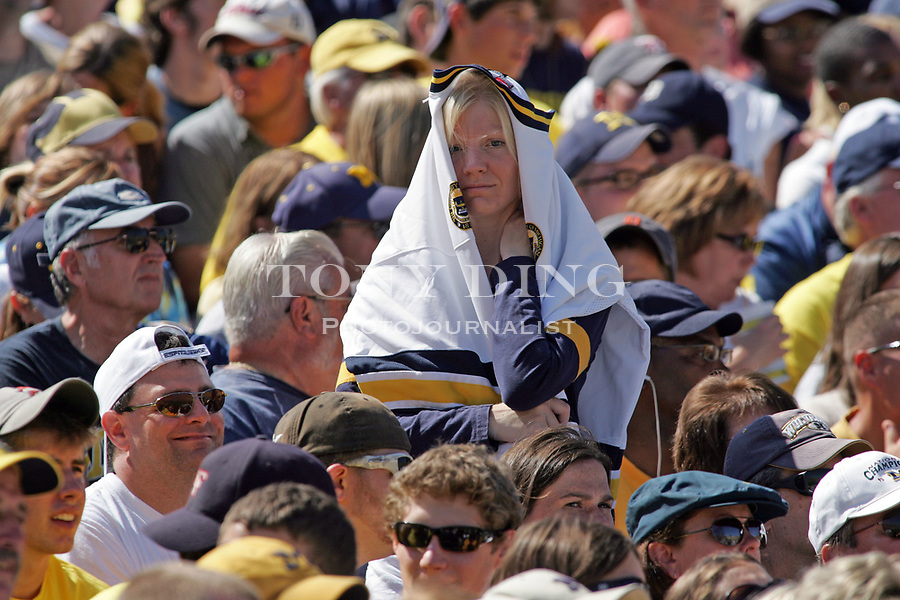 1 September 2007: A Michigan fan covers herself in a jersey during the 2007 season opener college football game between the Michigan Wolverines and Appalachian State Mountaineers at Michigan Stadium in Ann Arbor, MI. No. 5 ranked Michigan was upset 32-34.
