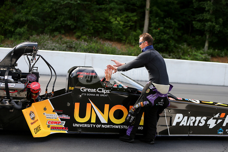 Jun 18, 2017; Bristol, TN, USA; NHRA top fuel driver Clay Millican celebrates with funny car driver Jack Beckman after winning the Thunder Valley Nationals at Bristol Dragway. Mandatory Credit: Mark J. Rebilas-USA TODAY Sports