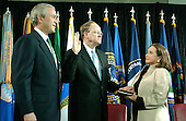 """Washington, D.C. - February 20, 2007 -- Retired Vice Admiral John Michael """"Mike"""" McConnell is sworn-in as the second Director of National Intelligence (DNI) in Washington, D.C. on Tuesday, February 20, 2007.  McConnell replaces John Negroponte.  From left to right: United States President George W. Bush; Mike McConnell; and Terry McConnell, wife.<br /> Credit: Ron Sachs - Pool"""