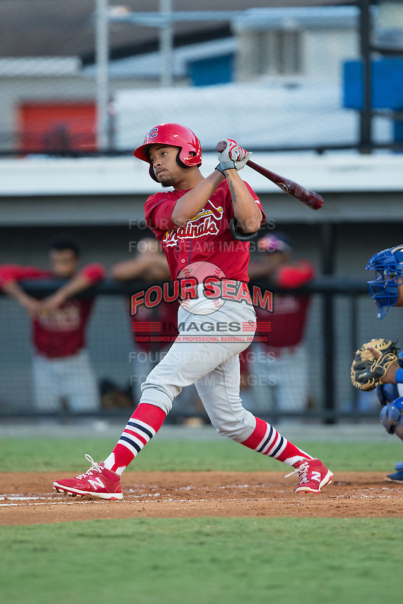 Edmundo Sosa (19) of the Johnson City Cardinals follows through on his swing against the Burlington Royals at Burlington Athletic Park on August 22, 2015 in Burlington, North Carolina.  The Cardinals defeated the Royals 9-3. (Brian Westerholt/Four Seam Images)