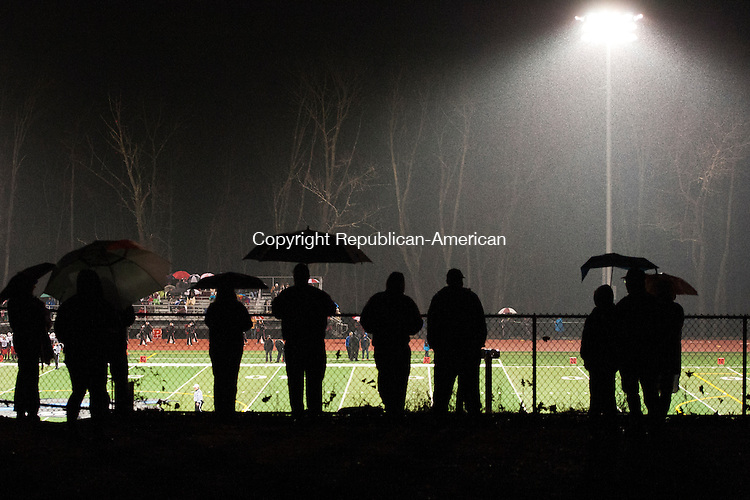 OXFORD, CT - 26 November 2013-112613EC09--      The rain didn't stop many spectators from watching the game at Oxford's stadium. The Wolverines defeated Pomperaug, 28-12, Tuesday night in Oxford. Erin Covey Republican American.
