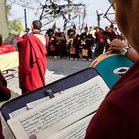 Nepal, Kathmandu, Swayambhunath.  Buddhist Monk Holding Text Written in two Styles of the Tibetan Alphabet.