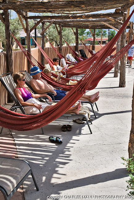 Visitors relax in hammocks at the Ojo Caliente Mineral Springs Resort and Spa near the village of Ojo Caliente, in northern New Mexico