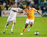 CARSON, CA - November 20, 2011: LA Galaxy midfielder David Beckham (23) and Houston Dynamo forward Carlo Costly (29) during the MLS Cup match between LA Galaxy and Houston Dynamo at the Home Depot Center in Carson, California. Final score LA Galaxy 1, Houston Dynamo 0.