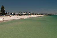 Henley Beach, its waters so turquoise as to be almost green, as seen from the jetty on a calm summer's day, Adelaide, South Australia.