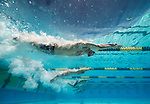 MESA, AZ - APRIL 25:  Michael Phelps, Carl Weigley, Mindaugas Saduaskas, Jimmy Feigen, and Nathan Adrian streamline at the start of the Men's 50M Freestyle Heats during the Grand Prix of Swimming on April 25, 2014 in Mesa, California. Phelps chose to swim the heat butterfly and did not qualify for finals, while Nathan Adrian went on the win the final later that evening. (Photo by Donald Miralle for Sports Illustrated)