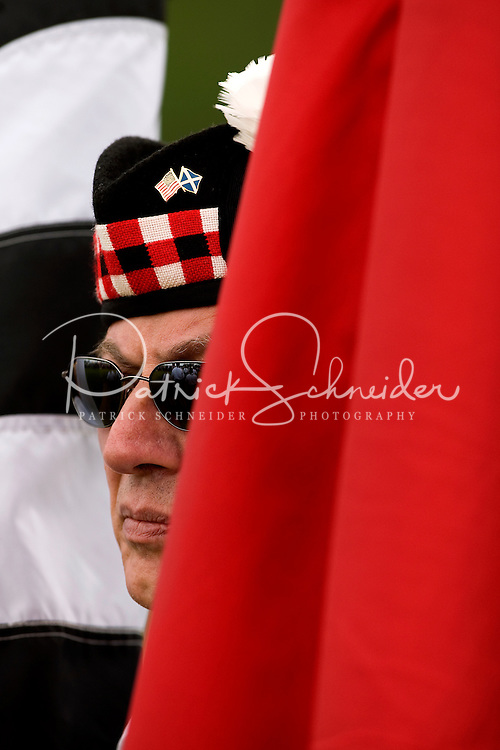 A man watches as bands perform during the Loch Norman games in Huntersville, NC.