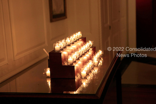 The candles lit by United States President Barack Obama and first lady Michelle Obama in the Map Room of the White House in Washington, D.C. on Saturday, December 14, 2013 to remember the 20 children and 6 adult school employees killed at the Sandy Hook Elementary School in New Town, Connecticut one year ago today.  <br /> Credit: Dennis Brack / Pool via CNP