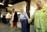 NWA Democrat-Gazette/DAVID GOTTSCHALK - 5/19/15 - Barb Carson (second from left), leads guests and members of the Rural Builders Club, an all-female group, in grace before lunch is served in the basement of Son's Chapel in Fayetteville Tuesday May 19, 2015. A 75th anniversary of the dedication of the chapel with an open house is planned for May 30.