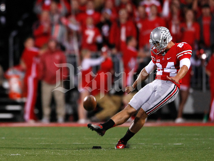 Ohio State Buckeyes punter Drew Basil (24) kicks off during the first quarter of a NCAA football game at Ohio Stadium on Saturday, October 6, 2012. (Columbus Dispatch photo by Jonathan Quilter)
