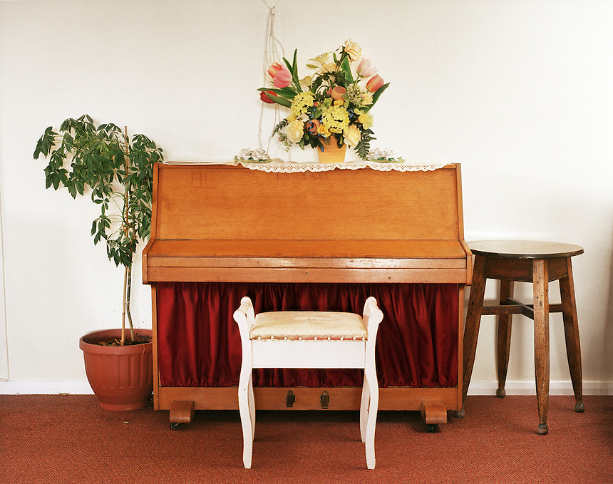 HATTERSLEY, UK - A piano sits in the lounge of a residential care home on the Hattersley Estate.. .The Hattersley Estate was created in the early 1960s to house residents displaced by the slum clearances of inner city Salford and Manchester and soon gained notoreity between 1963 and 1965 as the home to the Moors Murderers, Myra Hindley and Ian Brady. Lying in a relatively isolated area on the edge of the Pennines, residents today continue to wait for the investment and infrastructure promised to them decades ago. In the gap between promise and reality, a unique characted formed during years of adversity continues to thrive on the estate.