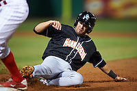 Jupiter Hammerheads designated hitter James Roberts (26) slides back into first during the second game of a doubleheader against the Clearwater Threshers on July 25, 2015 at Bright House Field in Clearwater, Florida.  Clearwater defeated Jupiter 2-1.  (Mike Janes/Four Seam Images)