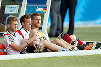 Andre Schurrle of Germany with Per Mertesacker and Kevin Grosskreutz