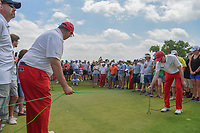 Jimmy Walker (USA) prepares to play limbo with a long putt up on to the green on 3 as two volunteers hold cables above his shot during round 3 of the AT&amp;T Byron Nelson, Trinity Forest Golf Club, at Dallas, Texas, USA. 5/19/2018.<br /> Picture: Golffile | Ken Murray<br /> <br /> <br /> All photo usage must carry mandatory copyright credit (&copy; Golffile | Ken Murray)
